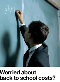 Young boy writing on a chalkboard